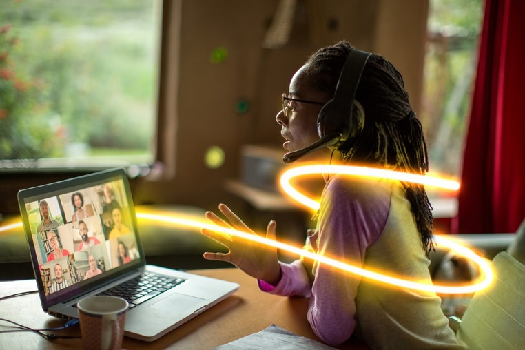 National Grid ESO - Network Options Assessment NOA 2020 - Woman on virtual meeting glowlines.jpg