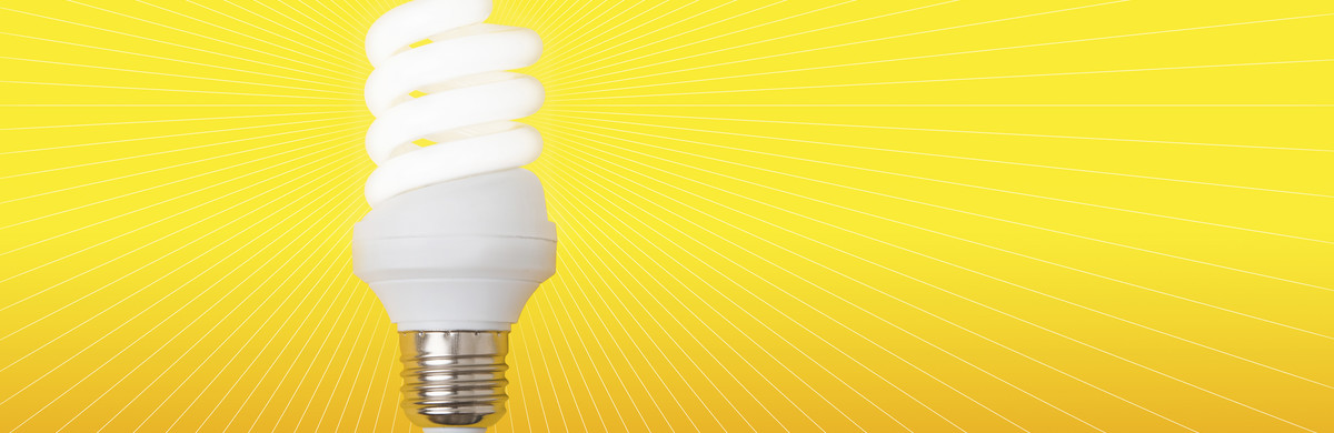A twist lightbulb with fine lights branching off from it over a yellow background