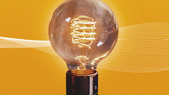 An exposed lightbulb with fine white lines behind it over an orange-yellow background