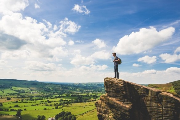 National Grid ESO - Bridging the gap report - teenager stands on edge in Peak District