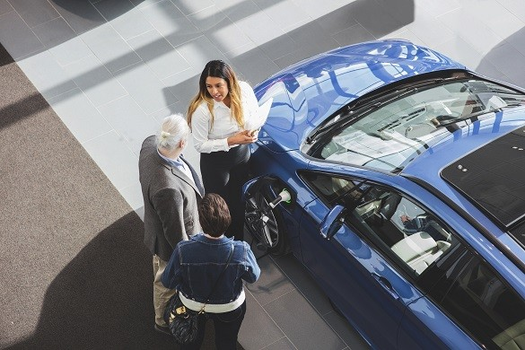 National Grid ESO - electric car myths - woman advising how vehicle to grid technology works